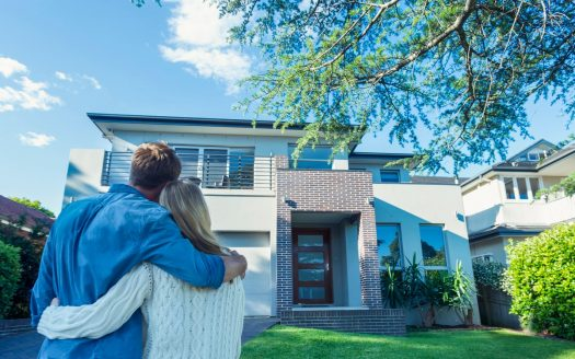 couple looking at house front