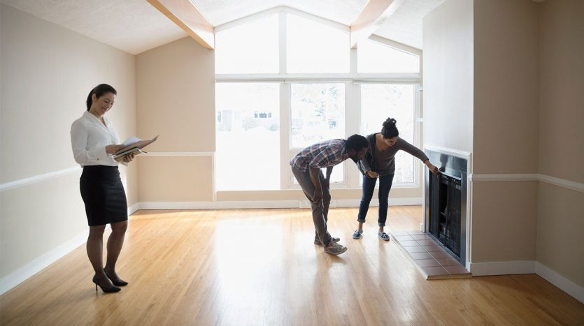 couple doing an open house inspection with real estate agent